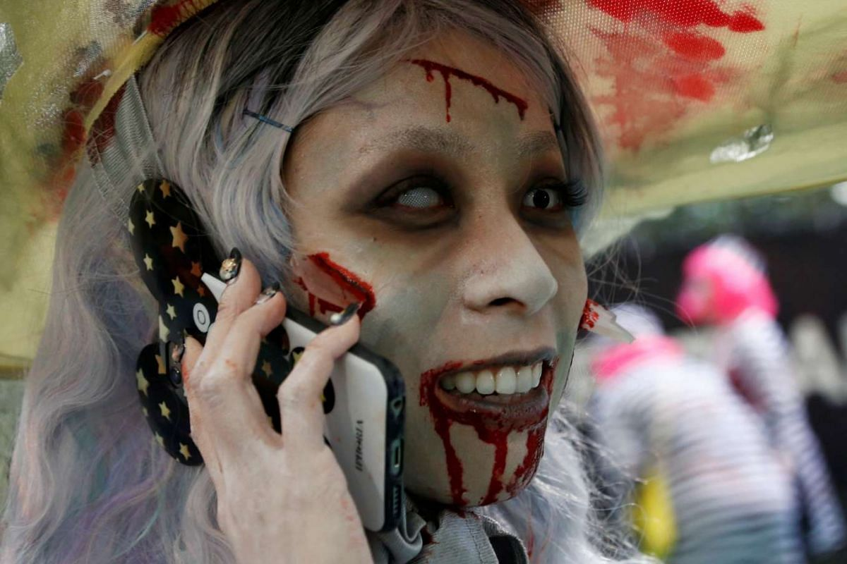 A participant in costume uses a mobile phone during the Kawasaki Halloween event in Kawasaki city on Oct 30, 2016.
