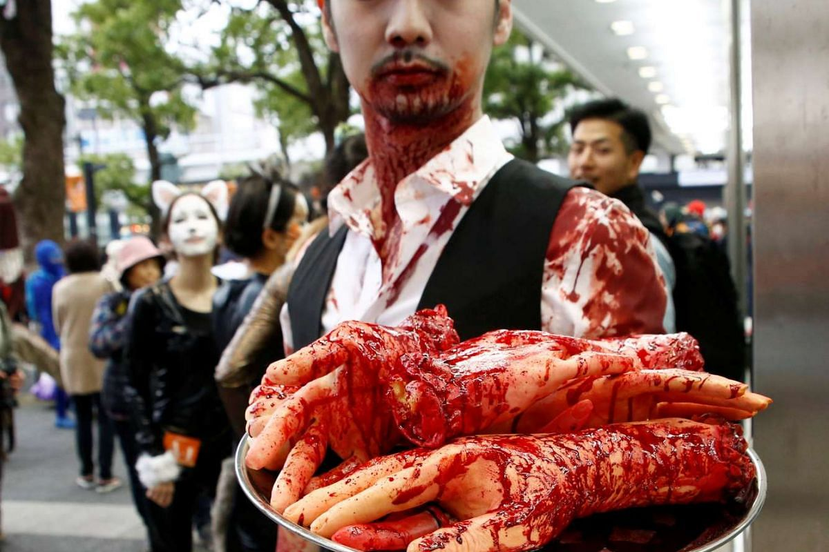 A participant in costume poses for a photo during the Kawasaki Halloween event in Kawasaki city on Oct 30, 2016.