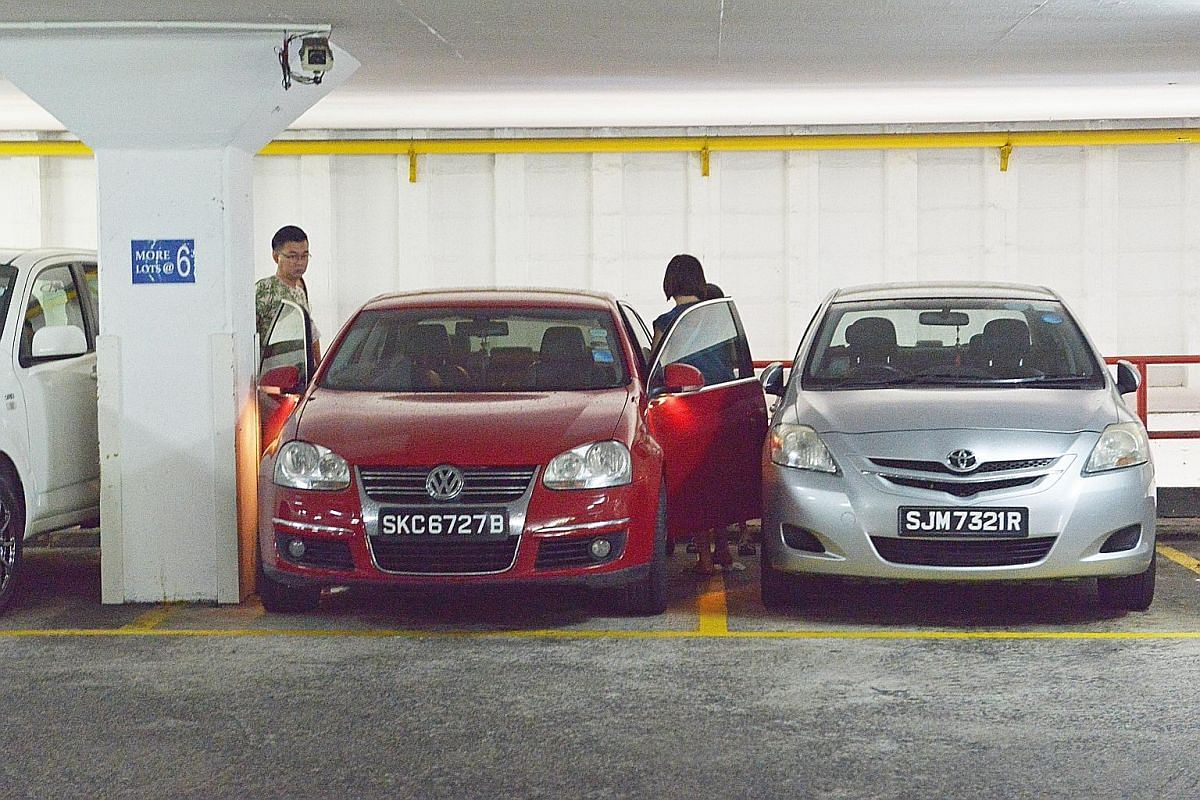 Singapore motorists are calling for spaces and ramps in carparks to be widened, as more are owning bigger cars now. Common complaints they have are difficulty getting in and out of their parked vehicles (left) and tough times navigating around tight