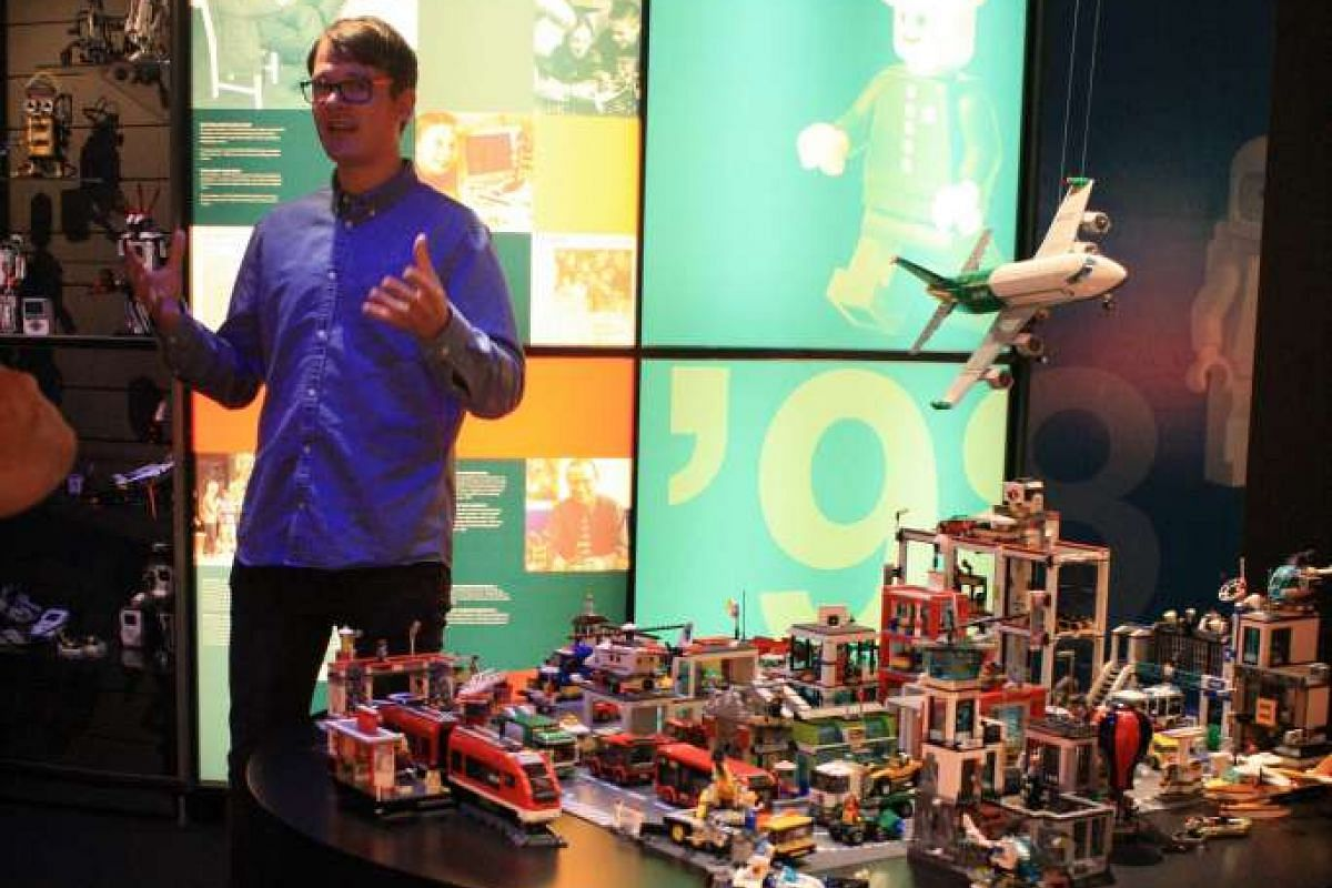Lego heritage manager Kristian Reimer Hauge talking about the brick toy's history at the Lego Idea House.