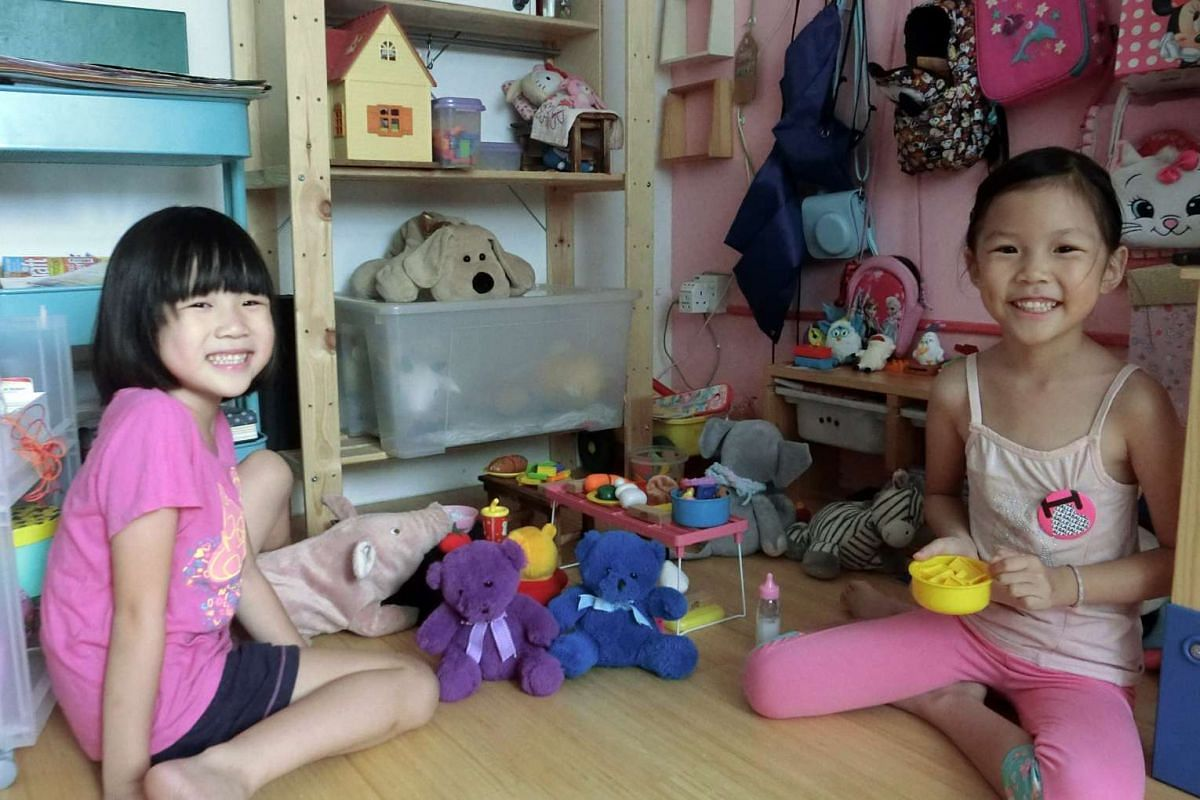 The Chua sisters Hope (left), six, and Deborah, eight, spend three to six hours a day playing as part of their homeschooling programme.