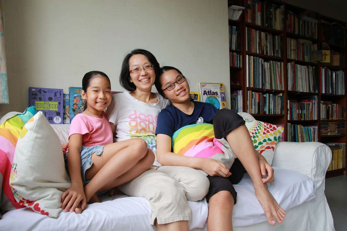 Ms Linda Khi and her daughters Shania (far left), turning nine, and Sara, 14.