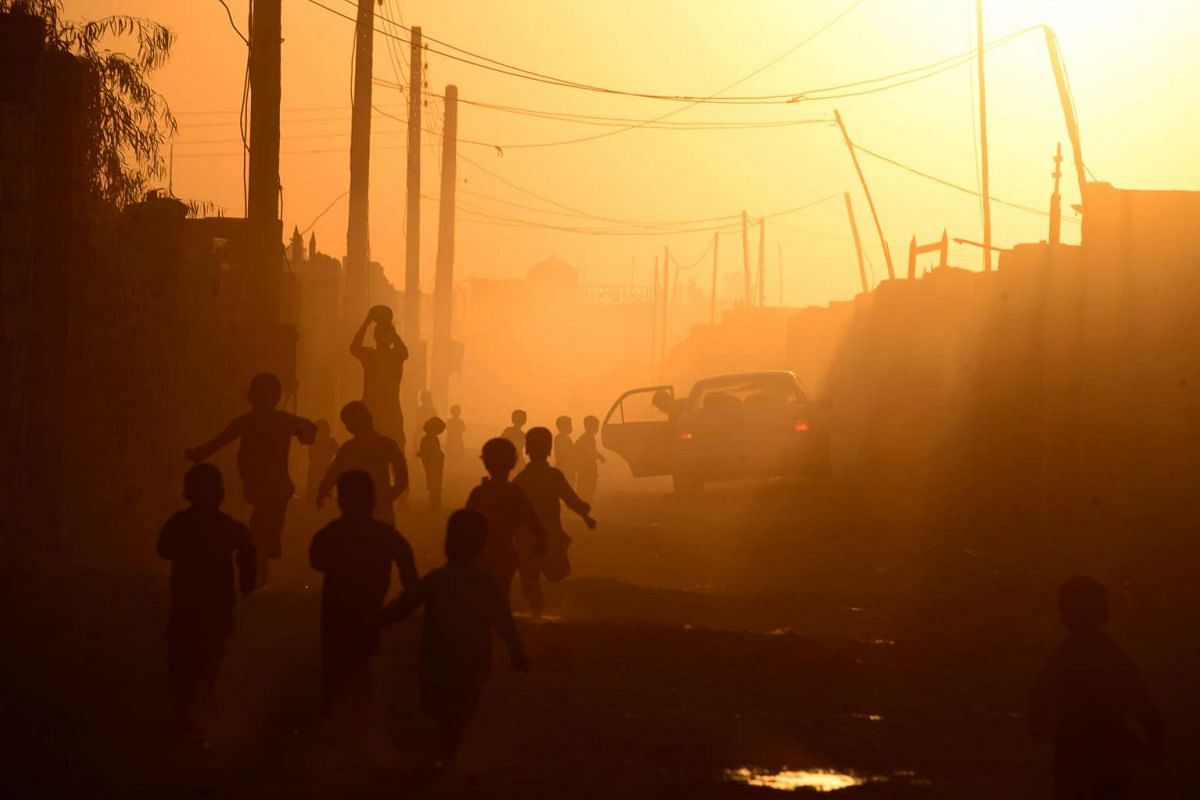 Afghan children play during sunset in Zaranj in the southwestern province of Nimroz on Oct 30, 2016.