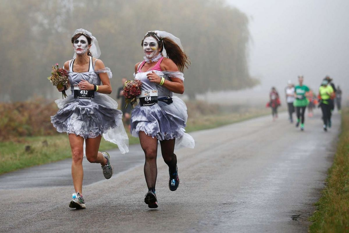 Participants take part in a Trick or Treat Halloween fun run in Richmond Park, London, Britain on Oct 30, 2016.