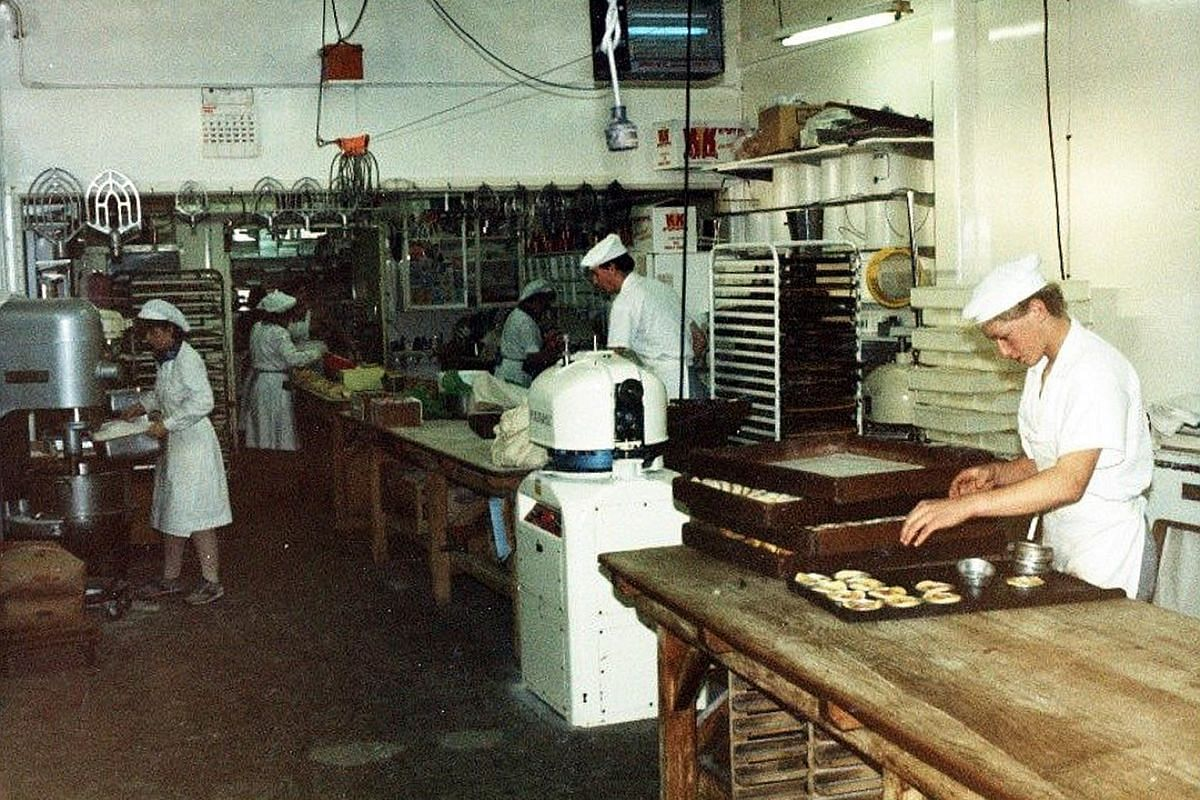 My life so far: Mr Dean Brettschneider (above) at the Rangiora Bakery in New Zealand where he apprenticed as a teenager; and with wife Vibeke and son Jason at Plank pizzeria in Opera Estate this year.