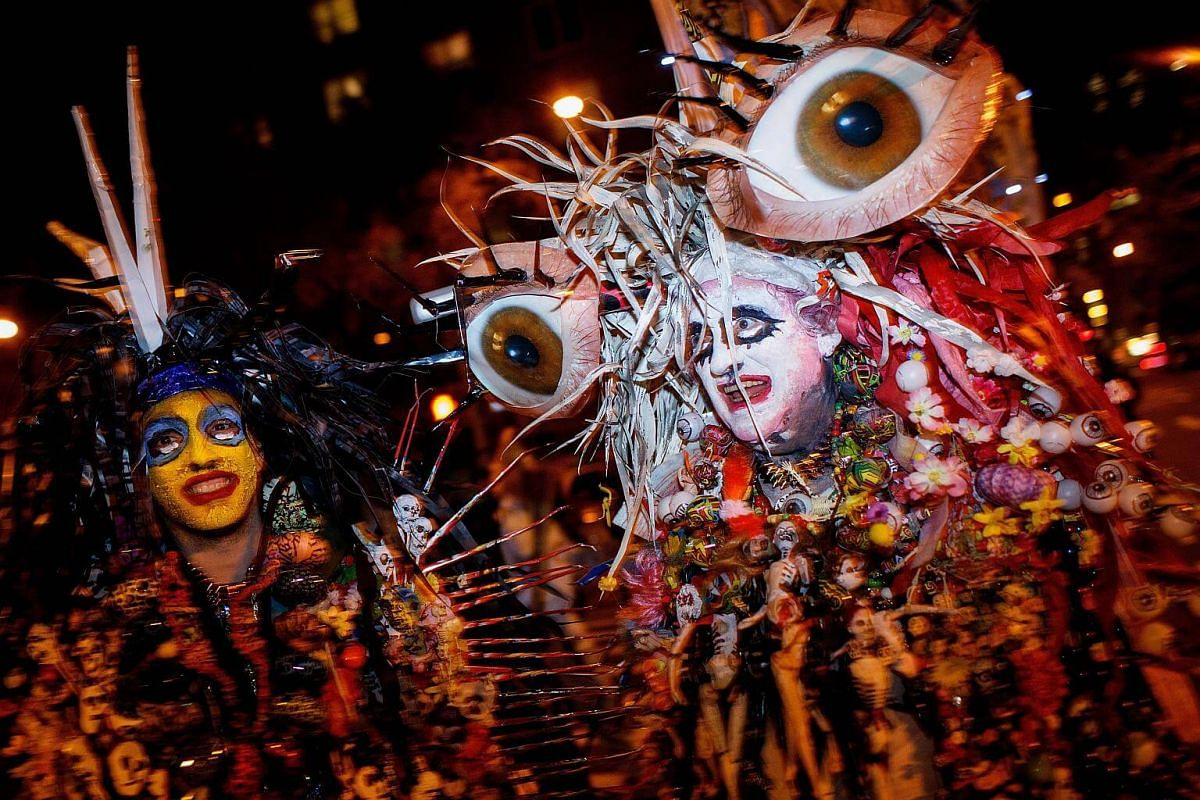 Revelers make their way along Sixth Avenue during the 43rd annual Village Halloween Parade.