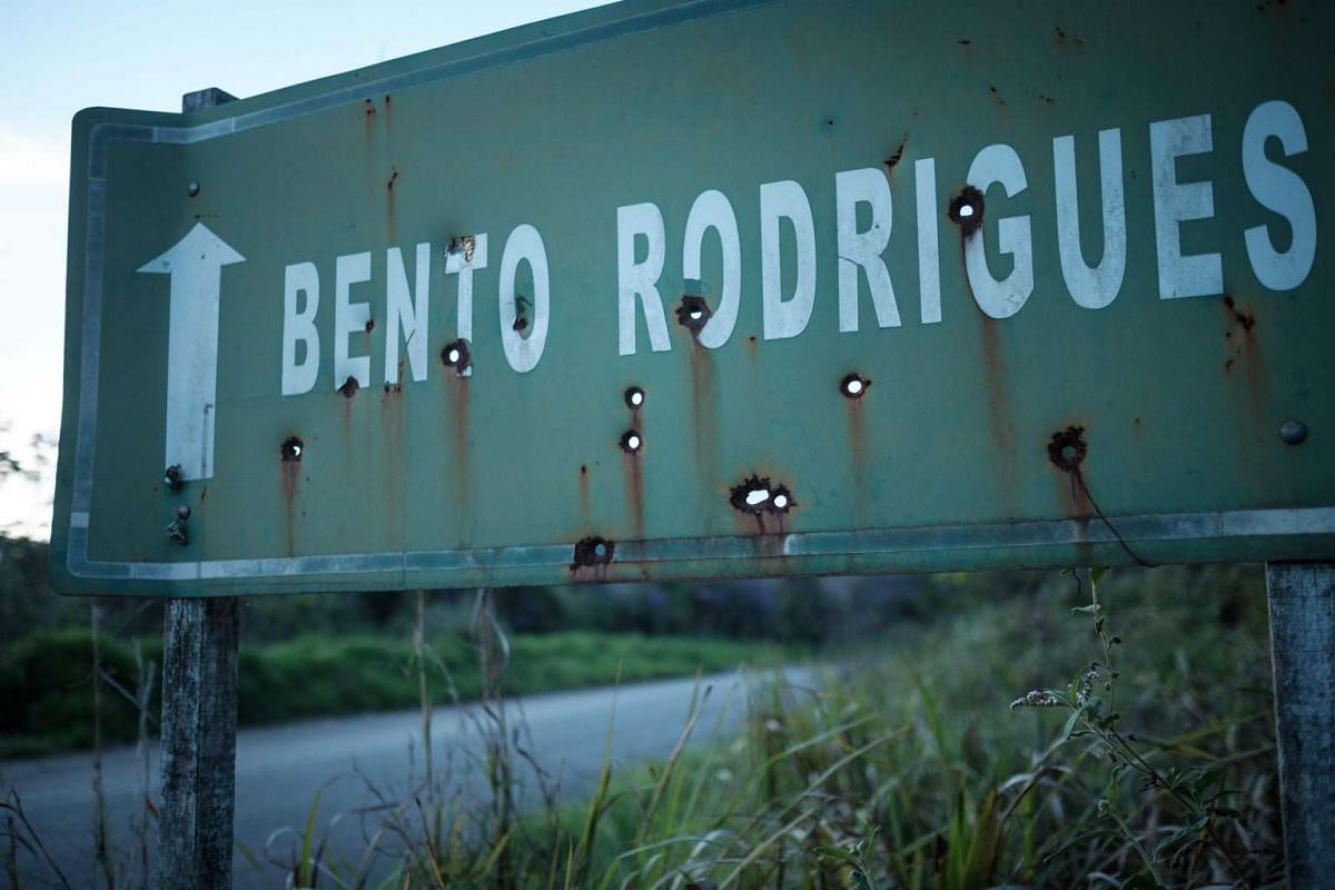 A sign shows the way to Bento Rodrigues village which has been ruined by the flood following the deadly collapse of the Samarco iron ore mine dam last year, in Mariana of Minas Gerais State, Brazil on Oct 26, 2016.