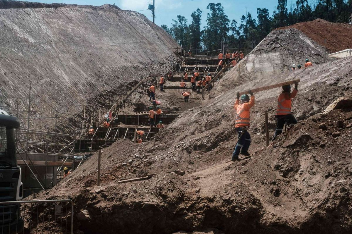 General view of workers at the rebuilding site next to the collapsed iron ore waste dam of Brazilian mining company Samarco, in Mariana, Minas Gerais State, Brazil on Oct 26, 2016.