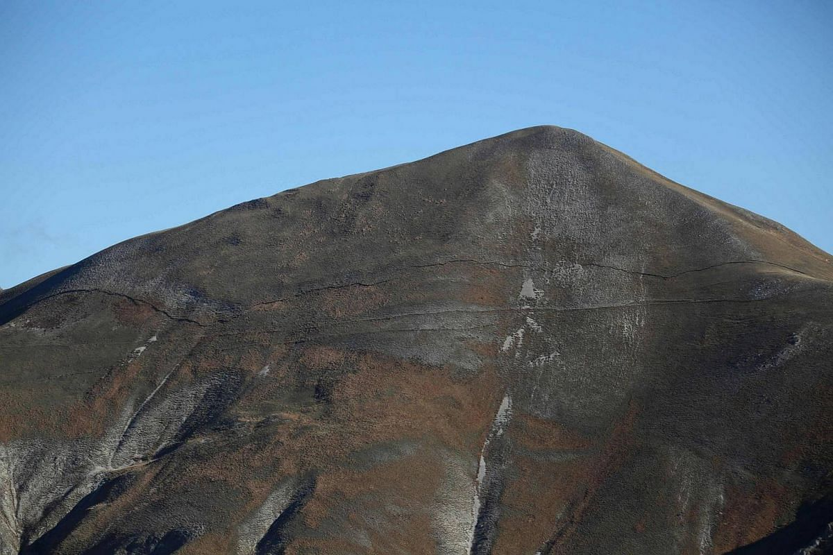 A huge crack on the Monte Porche, near Monte Vettore and Castelluccio in the Sibillini mountains, Italy, after a 6.5 magnitude earthquake on Oct 30, 2016.