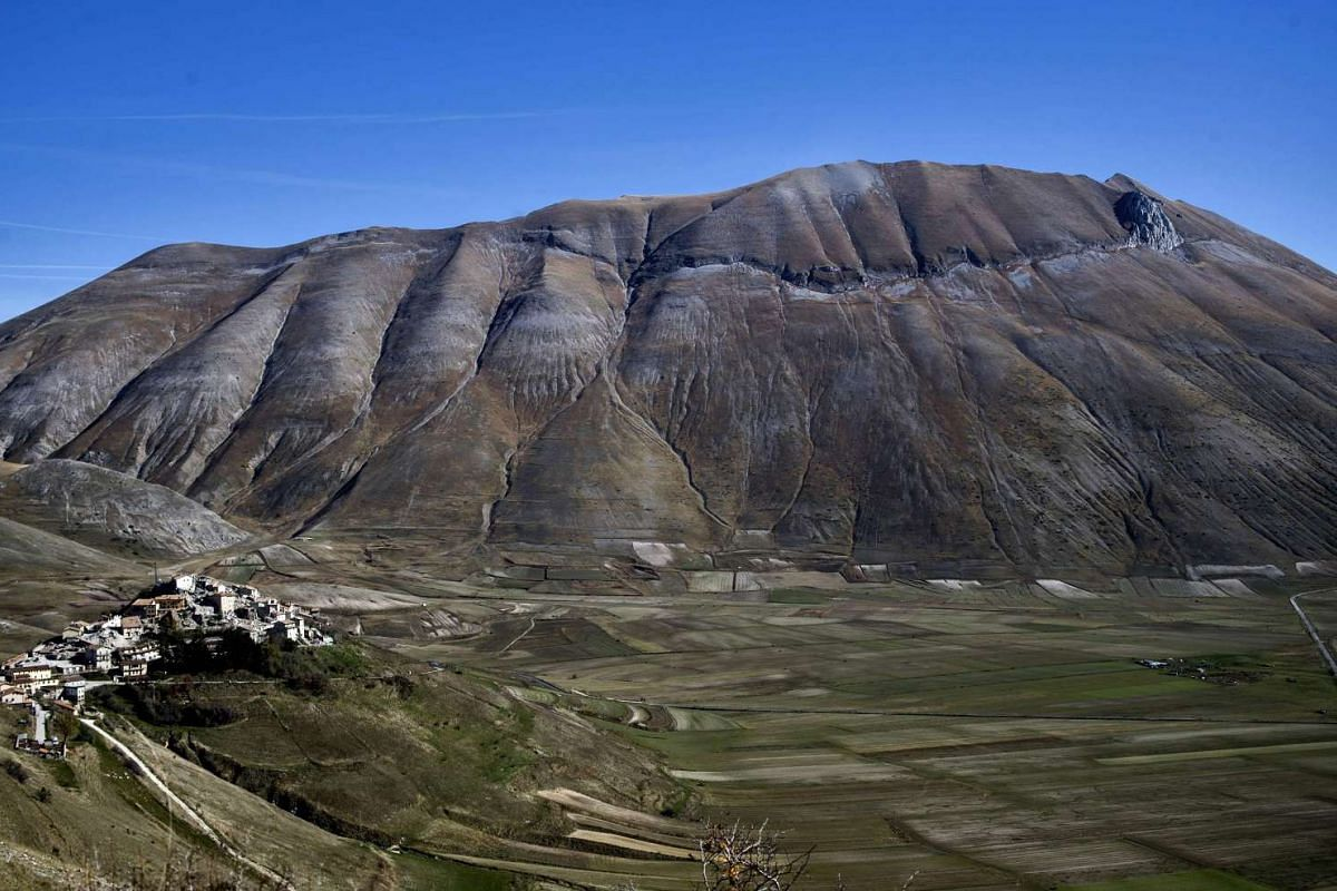 The village of Castelluccio and the Monte Vettore, three days after a 6.5 magnitude earthquake hit central Italy on Nov 2, 2016.
