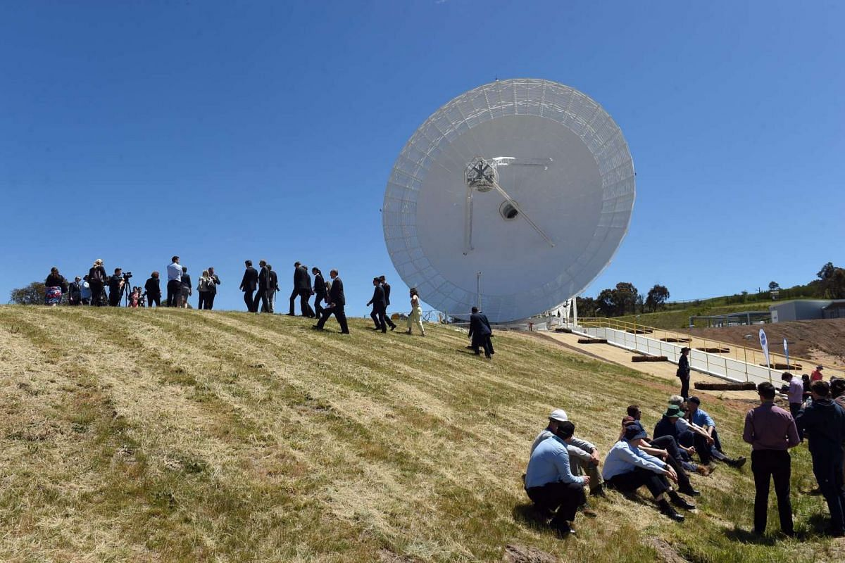 People attend the opening of the 34 metre beam waveguide antenna Deep Space Station 36 (DSS36) at the Canberra Deep Space Communication Complex in Canberra, Australia, on Nov 3, 2016.
