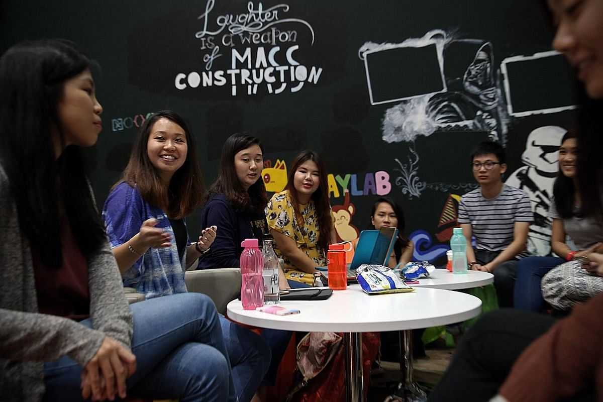 Ms Tan (second from left) at a meeting with her schoolmates at the Singapore Institute of Technology's student lounge. They are part of a 12-member group involved in Project Myanmar, an overseas learning project that will help to set up a pre-school
