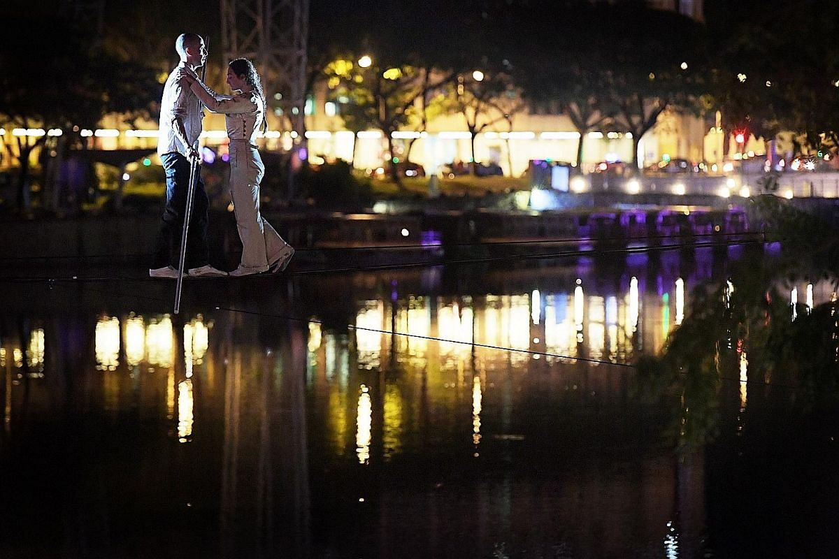 Lovers Mathieu Hibon and Chloe Moura of French performance group Underclouds Cie will make history as the first tightrope act to cross the Singapore River.