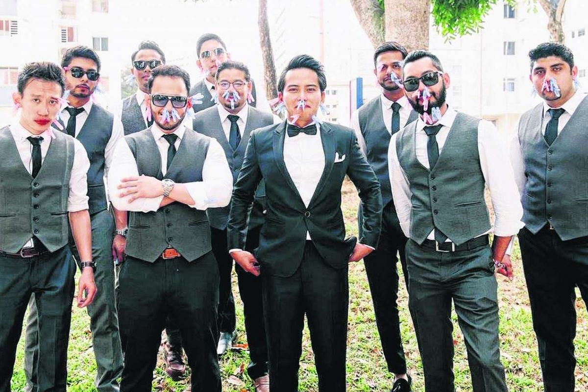 Madam Ayra Quek's husband and his nine groomsmen had to shake off clothespins from their bodies and faces while dancing to music.
