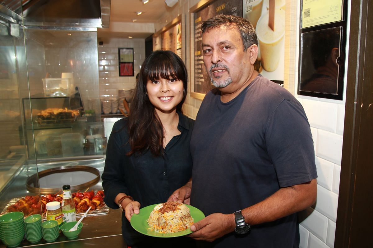 Mr Arif Salahuddin and his daughter Zara at their new outlet, Biryani Headquarters, in NTUC Foodfare at Simei MRT station.