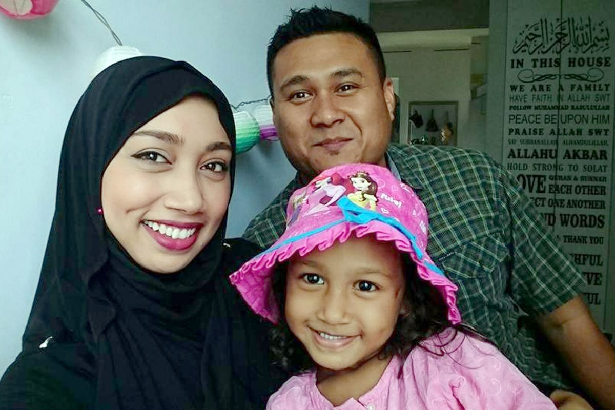 Ms Noretta Jacob (with her husband Mohamad Roslee Sulaiman) encourages her daughter, Nur Laaiqah, to engage in sensory play instead of using electronic devices.