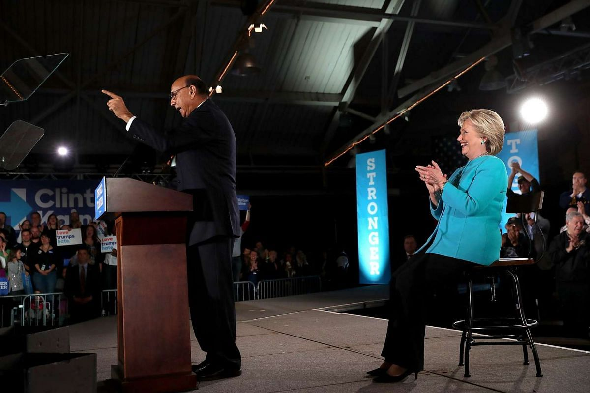 Khizr Khan speaks as Democratic presidential nominee former Secretary of State Hillary Clinton looks on during a campaign rally at The Armory on Nov 6, 2016.
