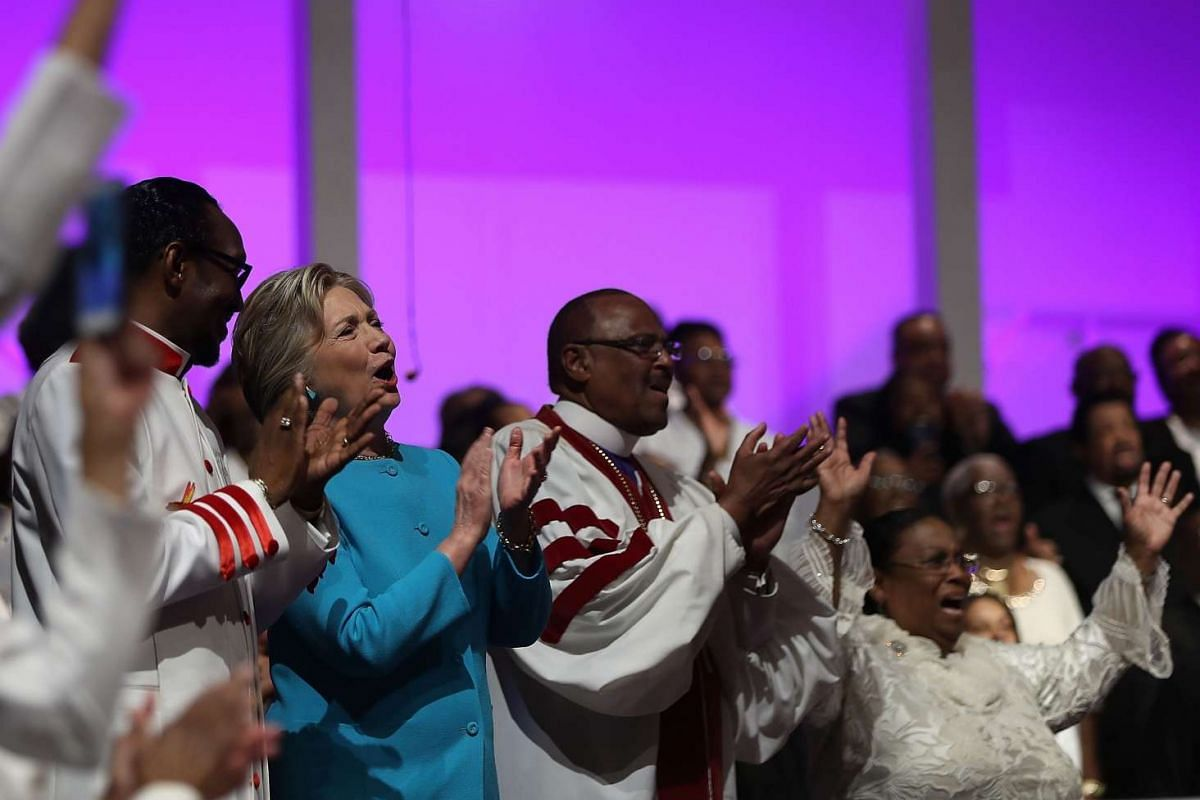 Democratic presidential nominee former Secretary of State Hillary Clinton sings during church services at Mt. Airy Church of God in Christ on Nov 6, 2016.