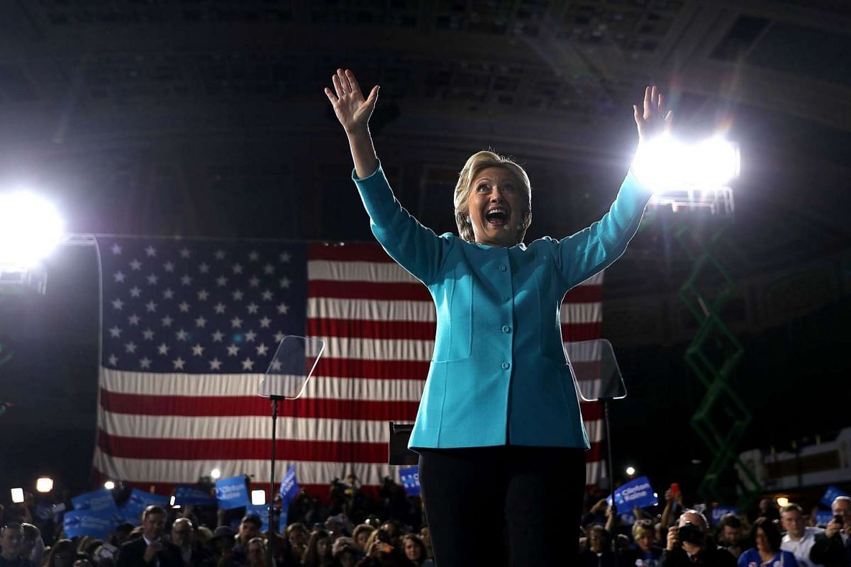 Democratic presidential nominee former Secretary of State Hillary Clinton greets supporters during a campaign rally at the Cleveland Public Auditorium on Nov 6, 2016.