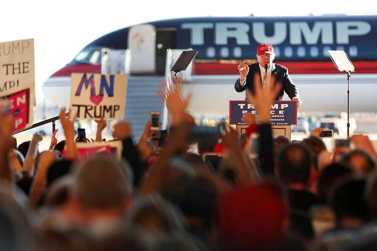 Republican US presidential nominee Donald Trump rallies with supporters in a cargo hangar at Minneapolis Saint Paul International Airport in Minneapolis, Minnesota on Nov 6, 2016.