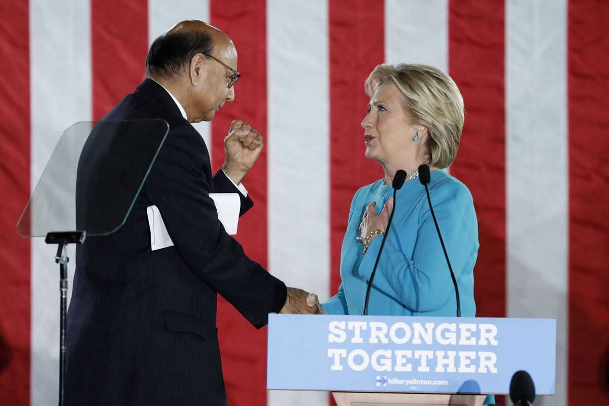 US Democratic presidential nominee Hillary Clinton thanks Gold Star Father Khizr Khan after he spoke at a campaign rally in Manchester, New Hampshire on Nov 6, 2016.