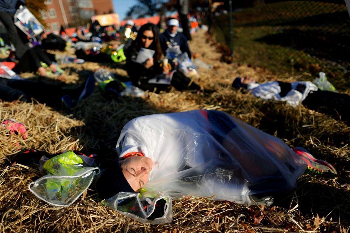 Runners sleep before competing in the 2016 New York City Marathon in the Manhattan borough of New York City on Nov 6, 2016.