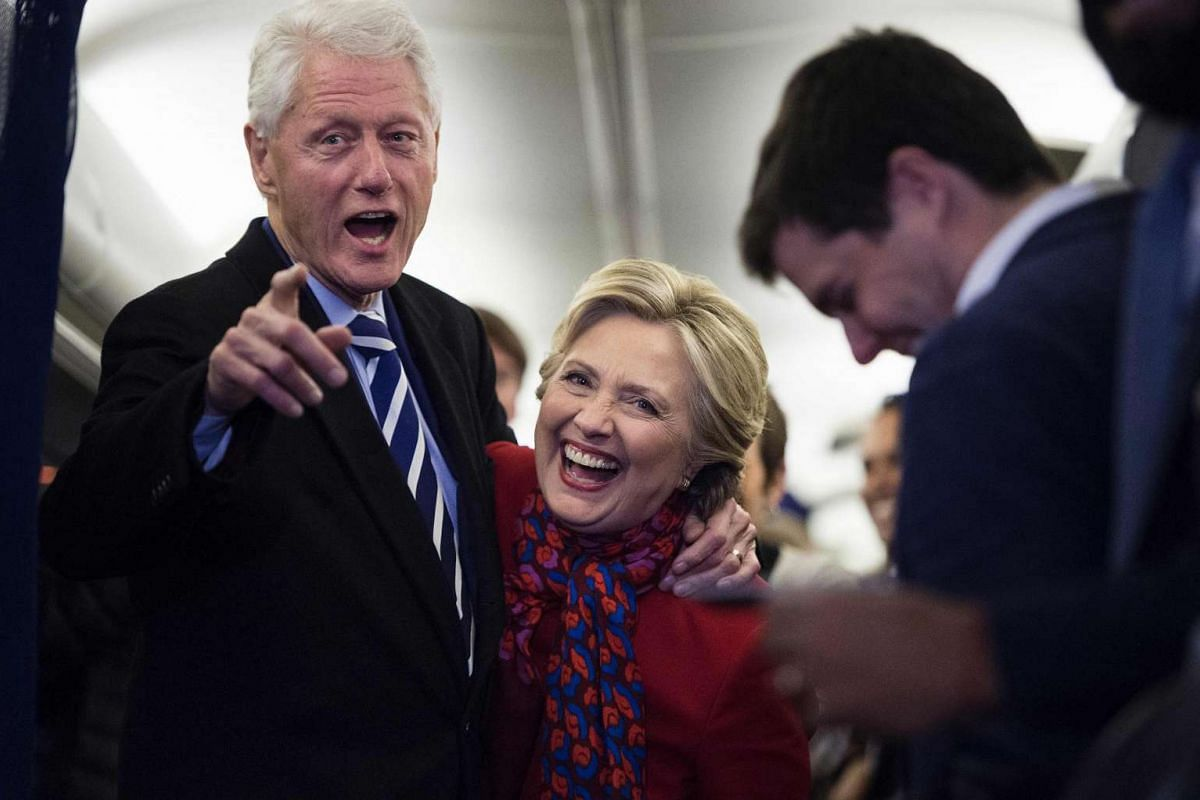 Democratic presidential candidate Hillary Clinton is joined by husband Bill on board her campaign plane at Philadelphia International Airport on Nov 7, 2016.