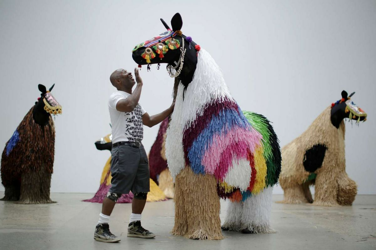 American artist Nick Cave talking to dancers dressed as a horse as he presents his first major work shown in Australia, entitled HEARD.SYD in Sydney, on Nov 8, 2016.