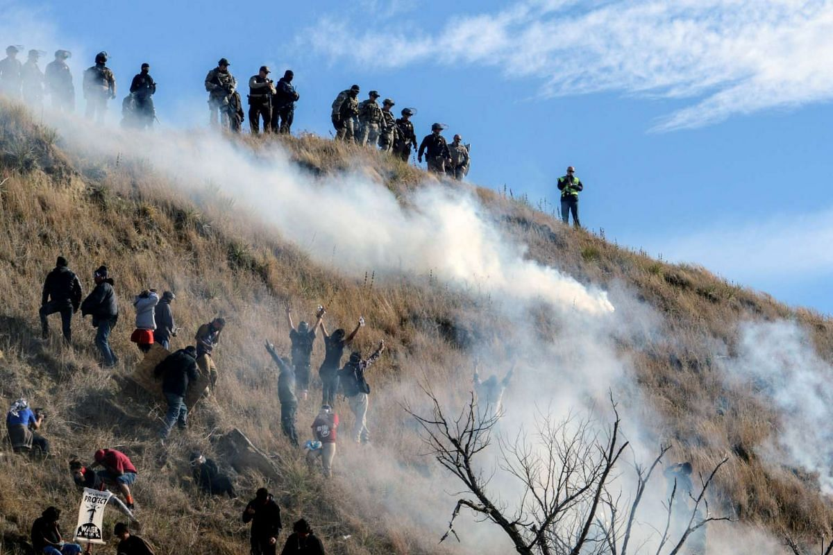 Police using tear gas on protesters occupying Turtle Island, during a protest against the Dakota Access pipeline near the Standing Rock Indian Reservation near Cannon Ball, North Dakota, on Nov 6, 2016.