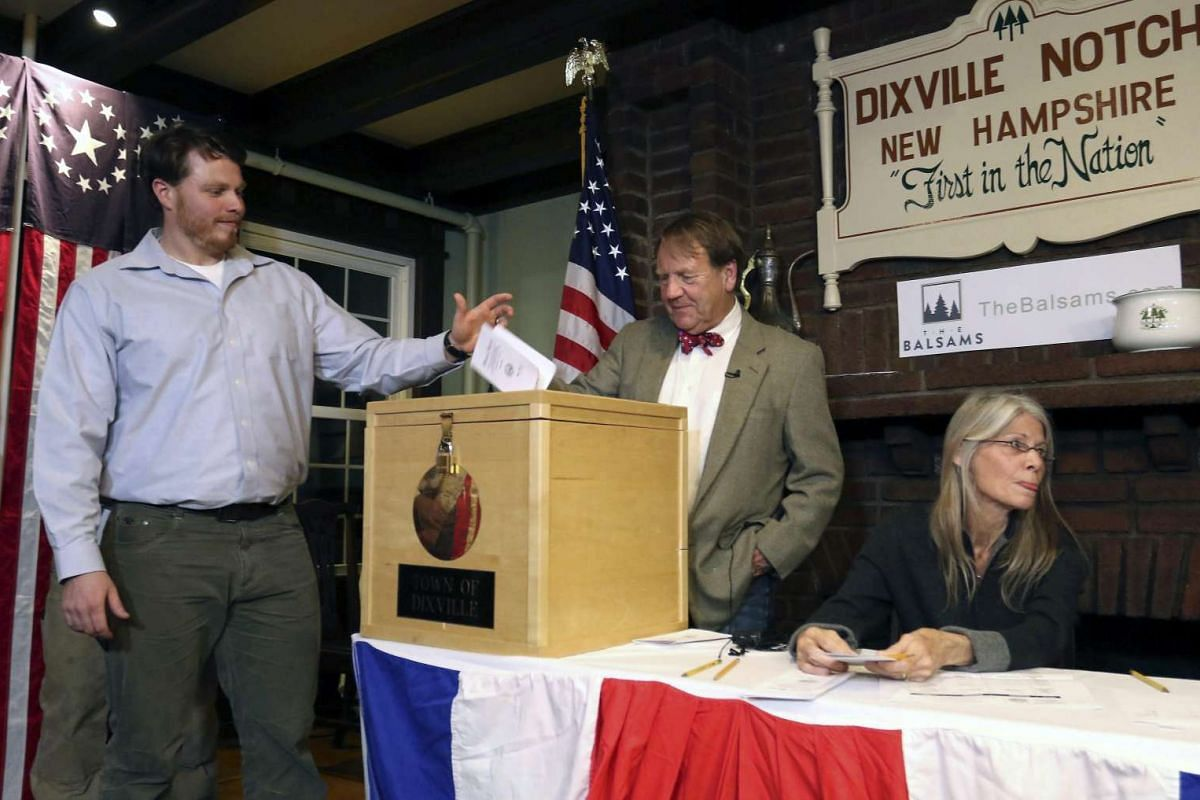 Clay Smith is the first voter to cast the ballot in the US presidential election, in the small village of Dixville Notch, New Hampshire, USA on Nov 8, 2016.