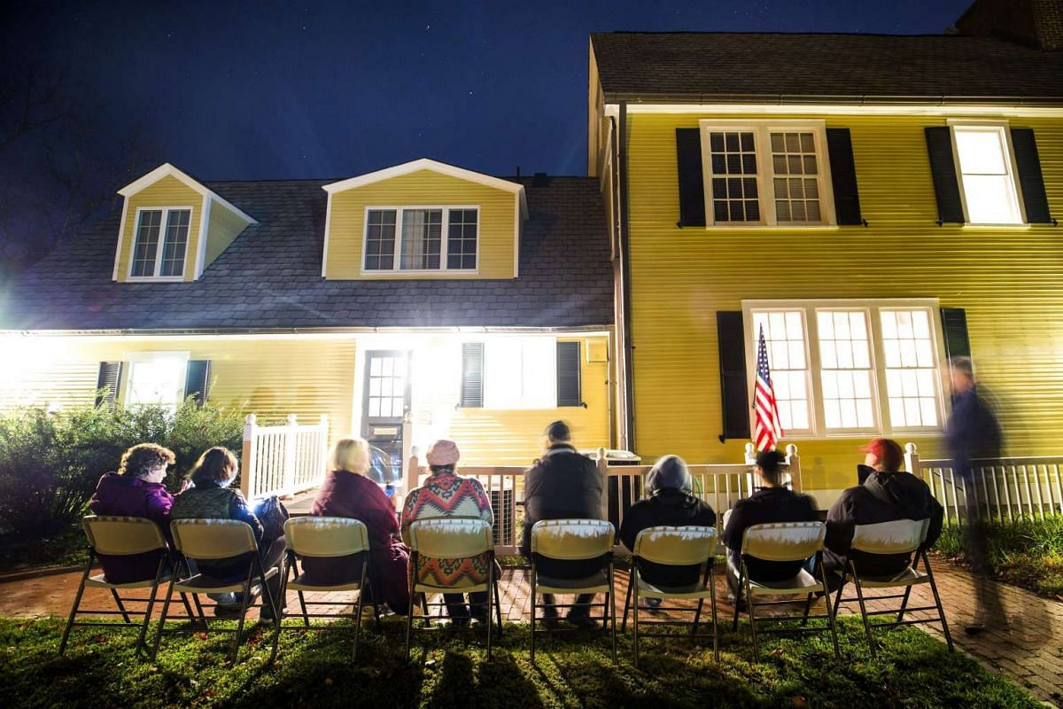Virginia residents wait in line in the pre-dawn hours to vote in the the 2016 US presidential election at an historic property called the Hunter House at Nottoway Park in Vienna on Nov 8, 2016.