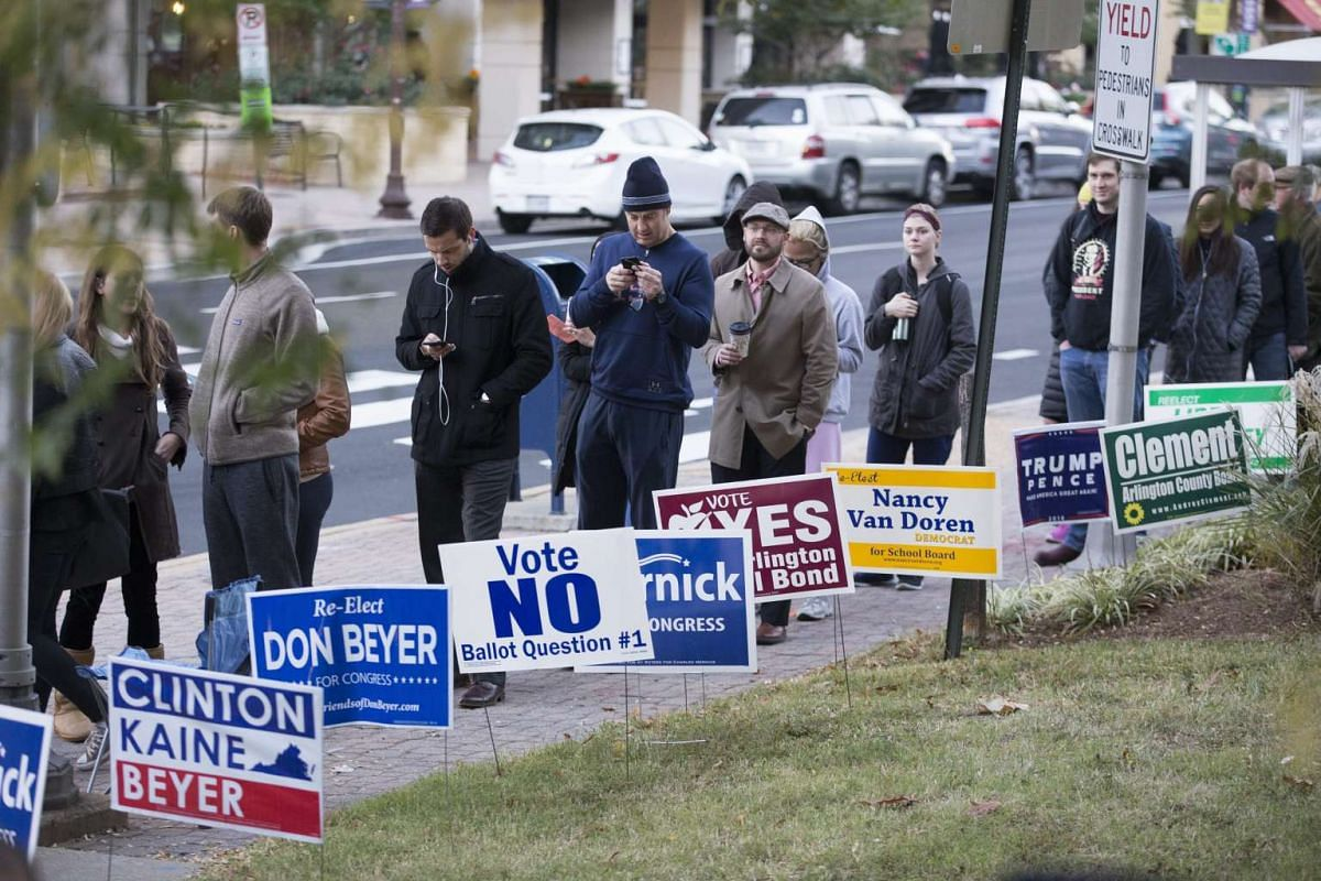 People wait in line outside a polling station in Arlington, Virginia, USA on Nov 8, 2016.
