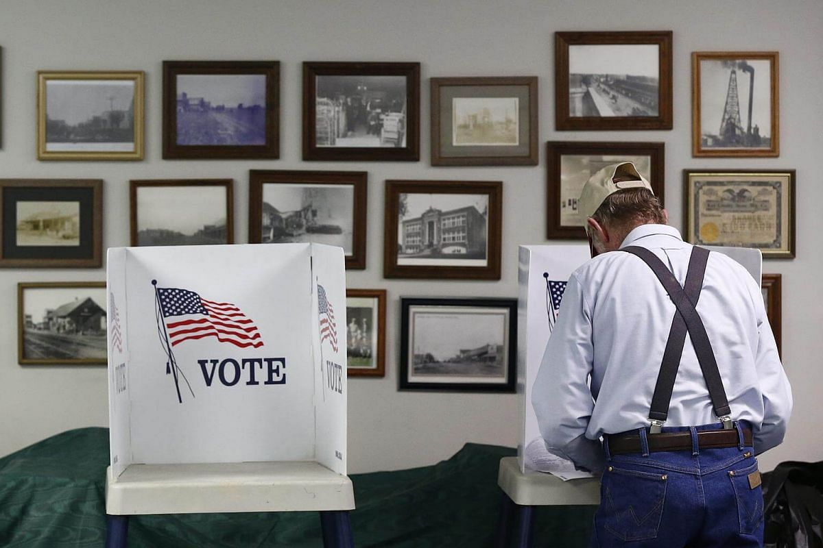 A voter filling out his ballot at the Community Building in Braman, Oklahoma.