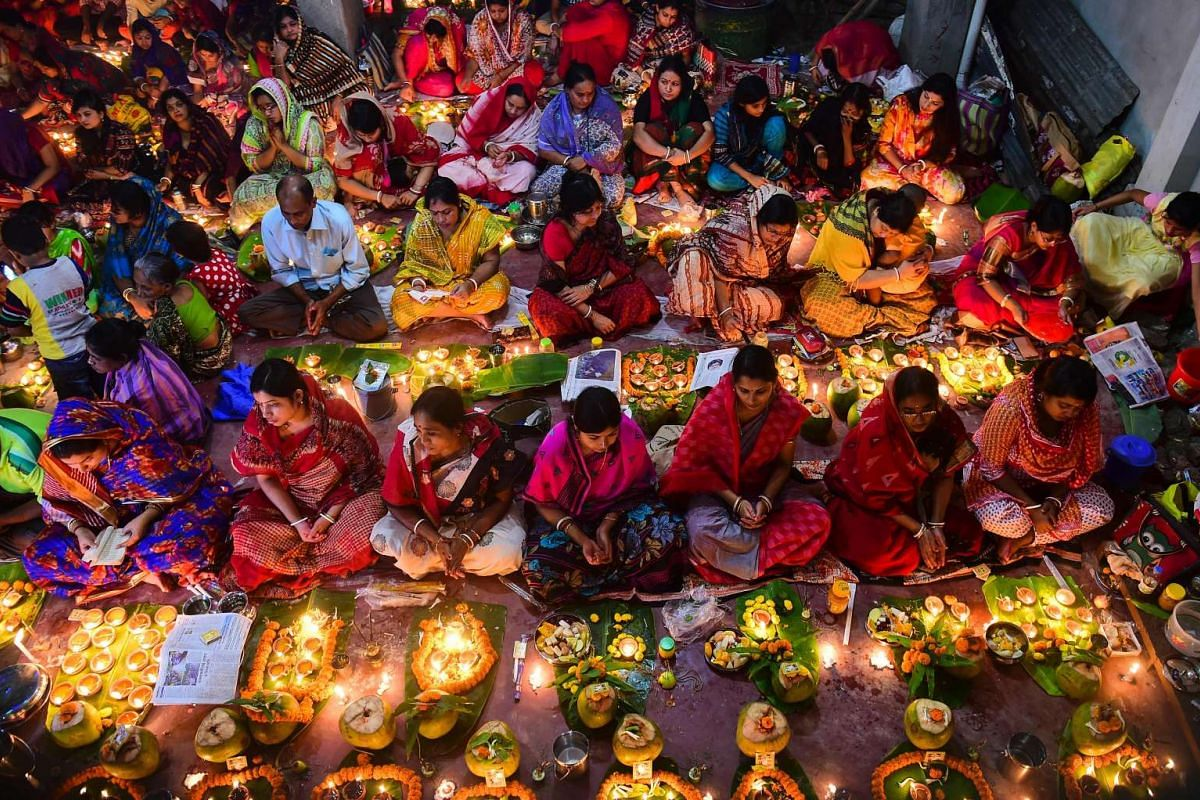Bangladeshi Hindu devotees offer prayers with incense sticks and oil lamps as they prepare to break their fast during the Rakher Updbas religious festival in Dhaka on Nov 8, 2016.