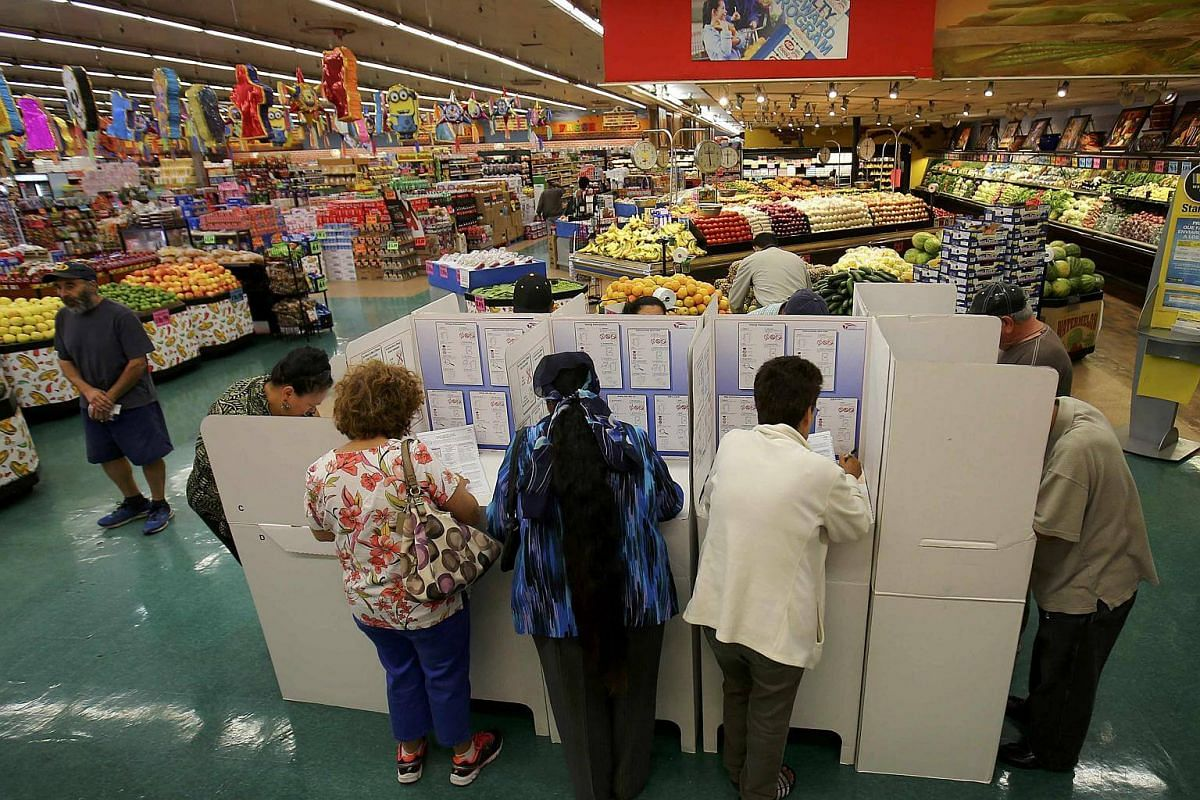 People cast their ballots at a neighborhood grocery store during voting in the 2016 presidential election in National City, California, US on Nov 8, 2016.