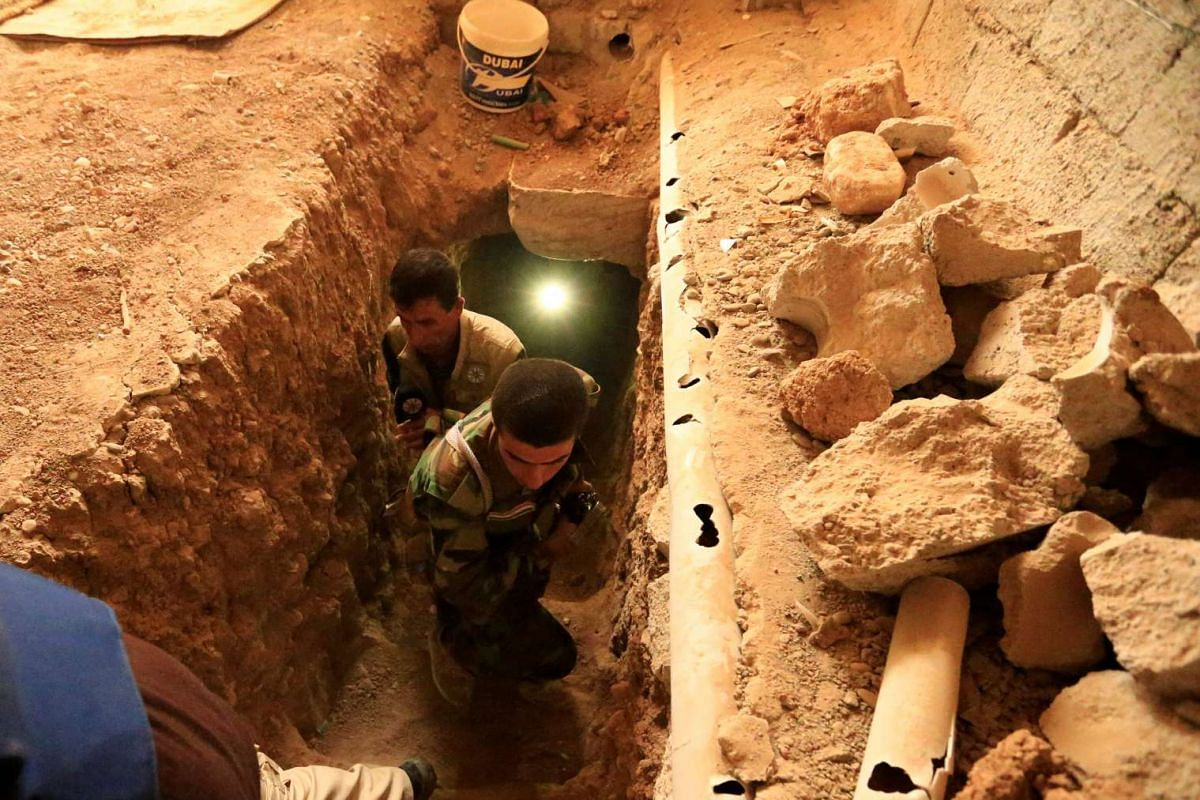 Peshmerga forces inspect a tunnel used by Islamic State militants in the town of Bashiqa, east of Mosul, during an operation to attack Islamic State militants in Mosul, Iraq on Nov 8, 2016.