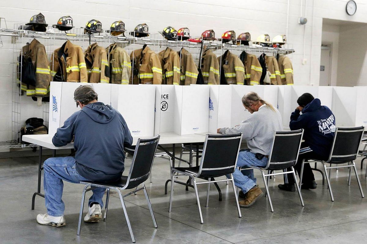 Voters filling out their ballots in the US presidential election at Elevation Fire Station in Benson, North Carolina.