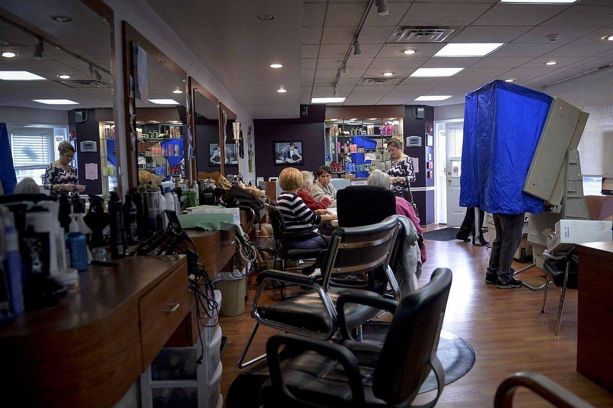 Voters casting their votes inside a hair salon in Philadelphia, Pennsylvania.