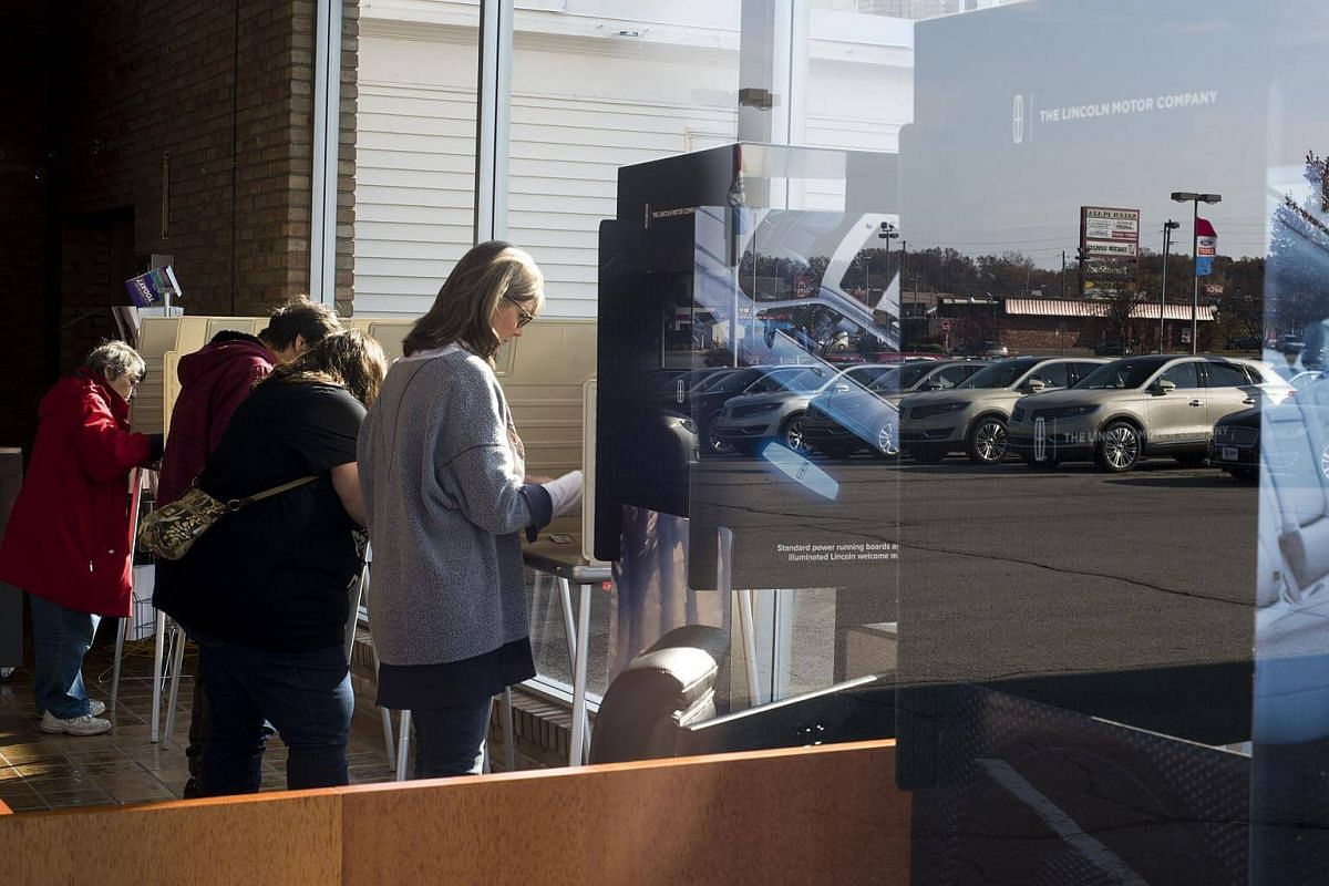 Voter casting their ballots at the Donnell Ford car dealership in Salem, Ohio.
