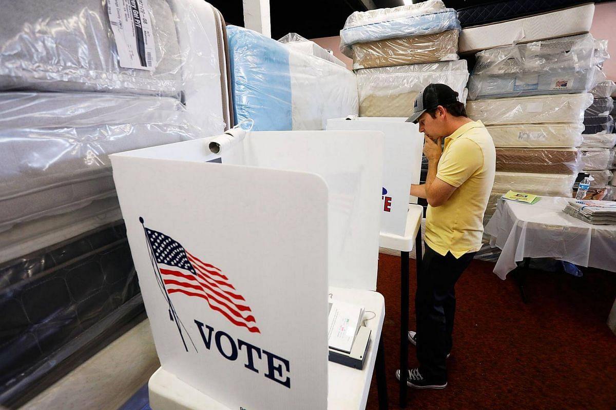 A man voting at Mattress Warehouse in Hawthorne, California.