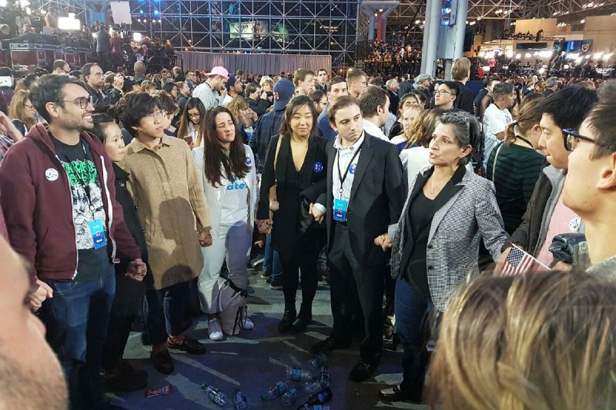 A group of Clinton supporters formed a circle to support each other at the Jacob Javits Convention Center on Nov 9, 2016.