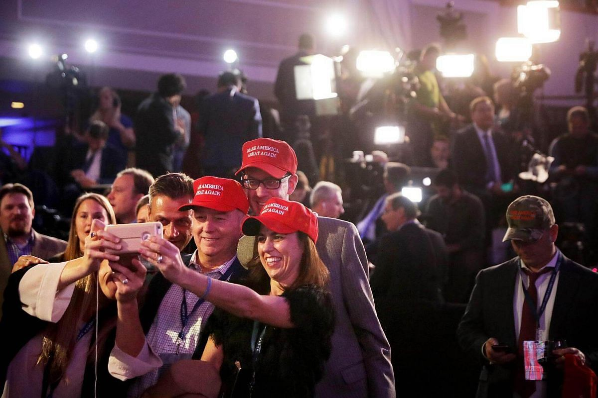 Supporters of Republican presidential nominee Donald Trump posing for a photo during the election night event at the New York Hilton Midtown on Nov 8, 2016.