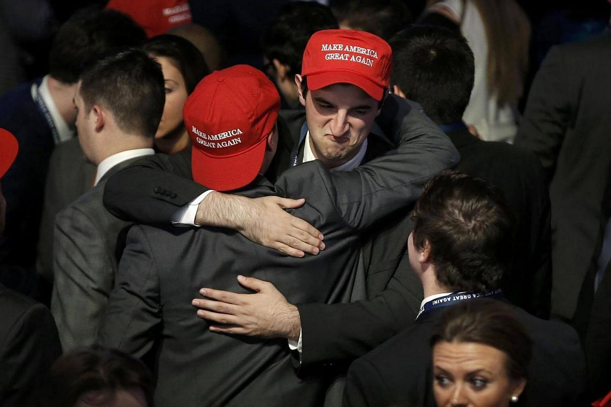 Trump supporters embracing as they watch election returns come in at Republican US presidential nominee Donald Trump's election night rally in Manhattan, New York, on Nov 8, 2016.