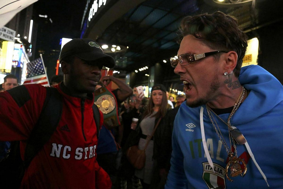 A supporter of US Republican presidential nominee Donald Trump (right) arguing with a supporter of Democratic nominee Hillary Clinton in Times Square in Manhattan, New York, on Nov 8, 2016.