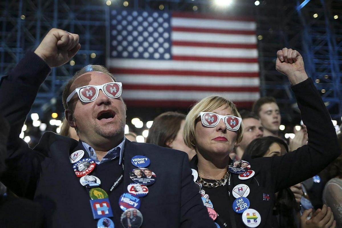 Mr Jim Livesey and Ms Jill Huennekens of Milwaukee cheering at Democratic US presidential nominee Hillary Clinton's election night rally at the Jacob K. Javits Convention Center in New York on Nov 8, 2016.