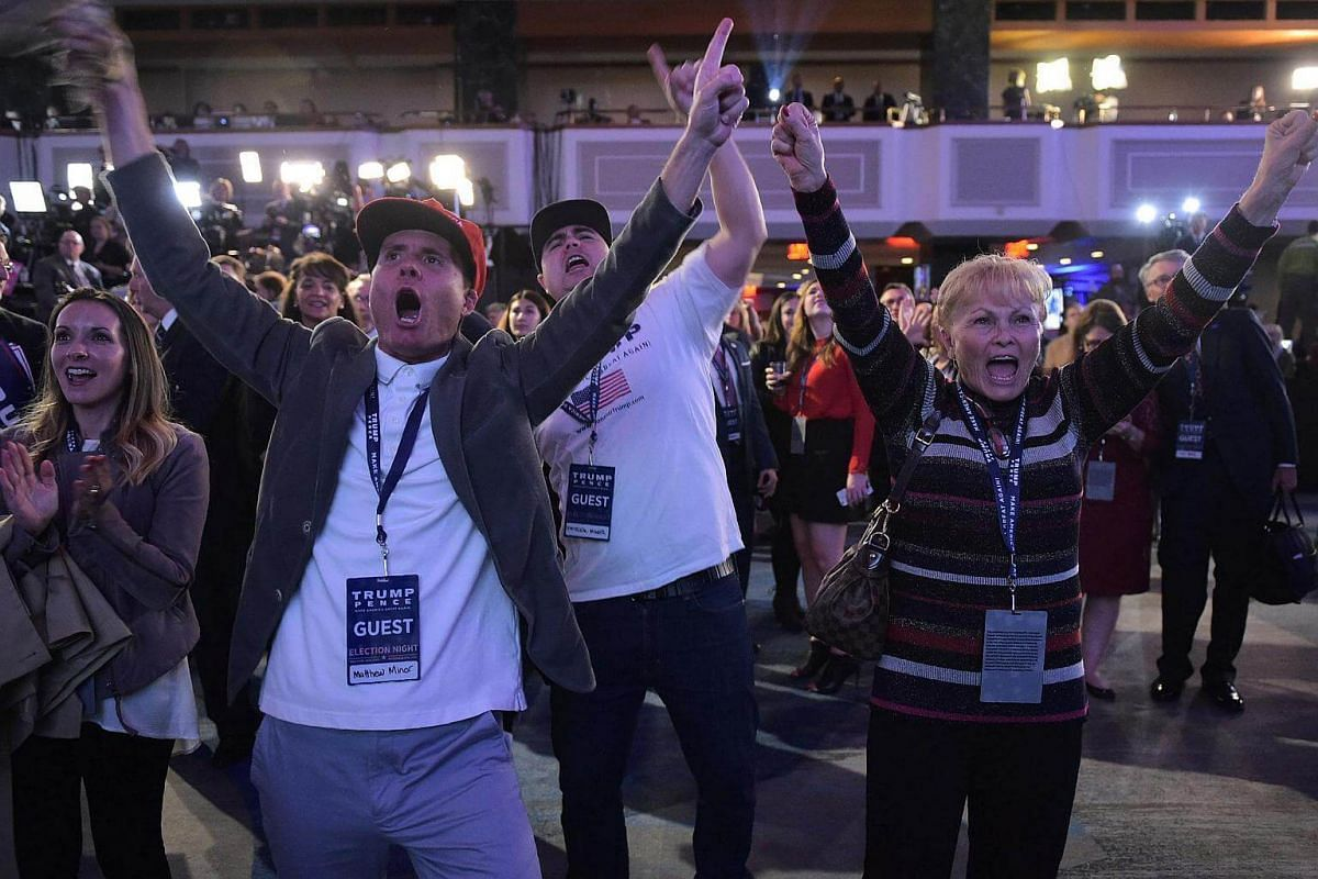 Supporters of Republican presidential nominee Donald Trump reacting to unfolding results on election night at the New York Hilton Midtown in New York on Nov 8, 2016.