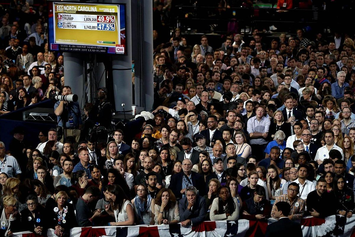 People watching voting results at Democratic presidential nominee Hillary Clinton's election night event at the Jacob K. Javits Convention Center in New York City on Nov 8, 2016.