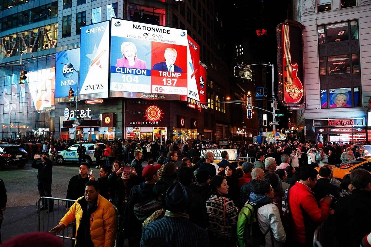People gathering around Times Square to see the results of the US presidential election on Nov 8, 2016, in Manhattan, New York.