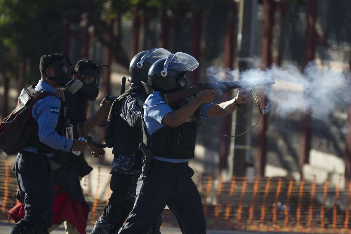 Honduran police officers fire tear gas as they clash with students in Tegucigalpa, Honduras on Nov 9, 2016.