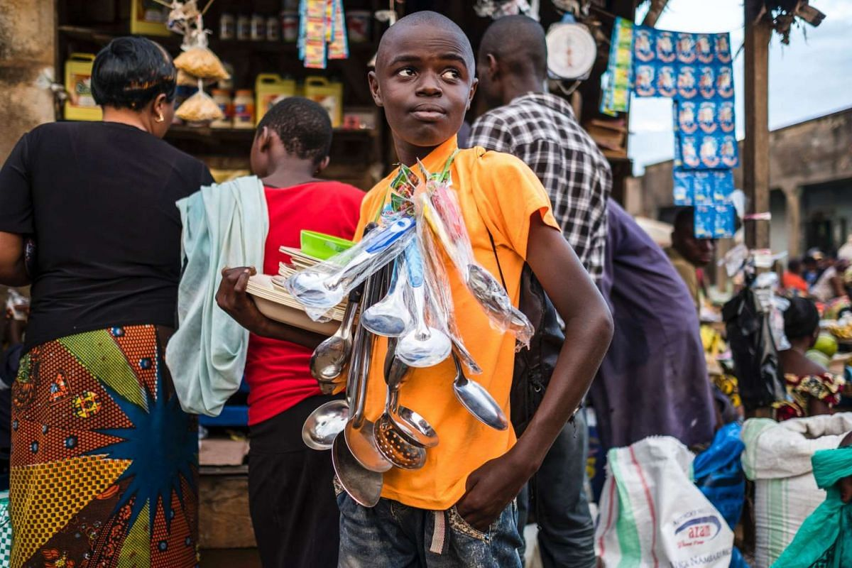 A boy sells kitchen ware at a market in Beni on Nov 9, 2016.